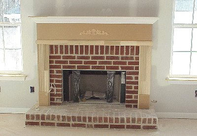 fireplace with unpainted mantel
