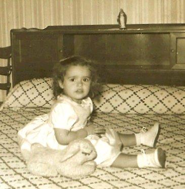 me, age 2, with stuffed bunny
