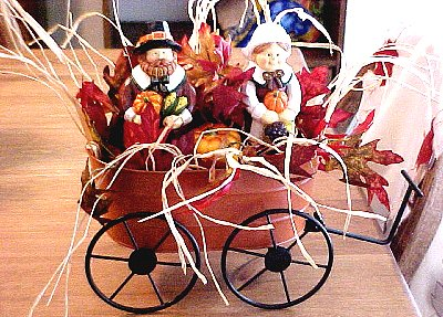 Pilgrims and leaves in cart