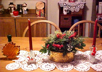 table and china cabinet with winter decorations